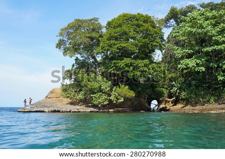 Caribbean shore of Costa Rica with a natural cave in the rock and lush tropical vegetation, Punta uva, Puerto Viejo - stock photo