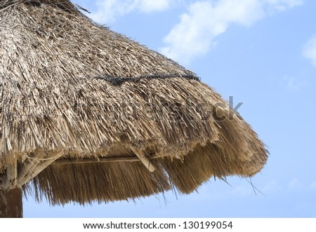 Caribbean Sun Umbrella on the beach - stock photo