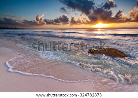 Caribbean Sunrise near Playa del Carmen, Riviera Maya, Mexico. The long exposure creates an artistic motion effect.