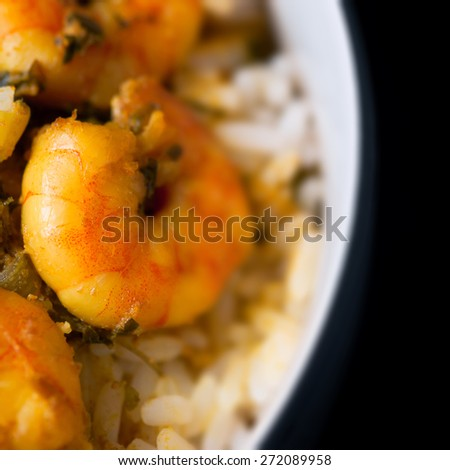 Caribbean tasty curry shrimp prawns and white rice - stock photo