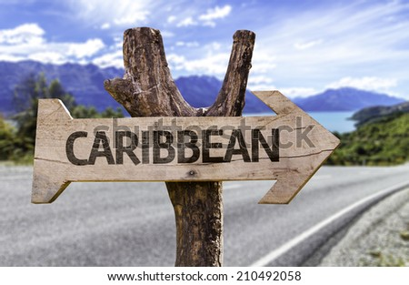Caribbean wooden sign with a highway on background - stock photo