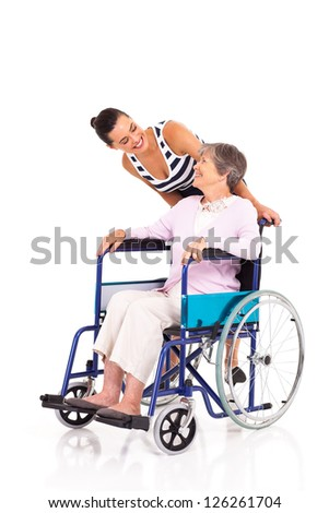 caring daughter talking to disabled senior mother isolated on white - stock photo