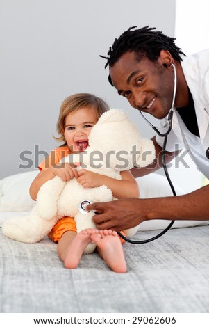 Caring Doctor with a child in a hospital - stock photo