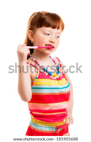 caring for baby teeth. Girl with toothbrush isolated on white background