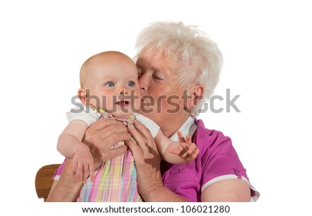 Caring granny kissing her little grandchild - isolated on white - stock photo