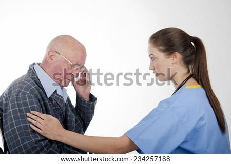 Caring Nurse With Elderly Patient - stock photo