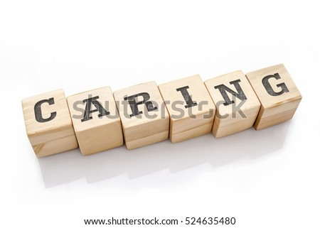 CARING word made with building blocks isolated on white