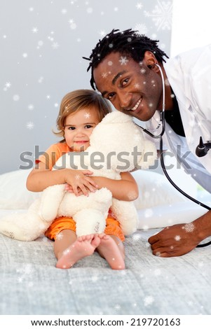 Caring young doctor with cute girl with snow falling