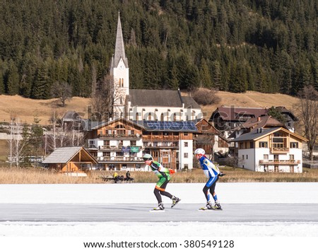 CARINTHIA, AUSTRIA - JANUARY 25: A pair of skaters skating on the ice in Carinthia, 2015 - stock photo