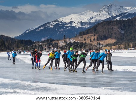 CARINTHIA, AUSTRIA - JANUARY 25: Many skaters skating on the ice in the Alps in Carinthia, 2015 - stock photo