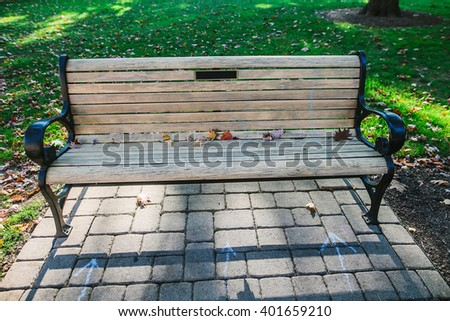 CARLISLE, PA, USA - OCTOBER 16, 2015: Bench at the Dickinson College campus. - stock photo