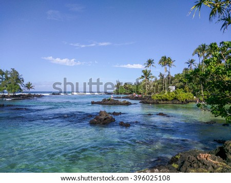 Carlsmith beach park is one of best places to swim and snorkel close to Hilo. Lava and a reef protect the inner swimming area, making it almost like a swimming pool. - stock photo