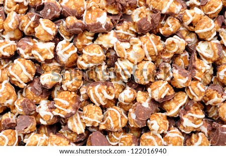 carmel and chocolate popcorn for background uses - stock photo