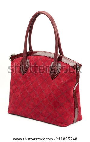Carmine suede female leather bag isolated on white background.