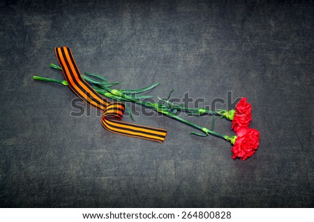 Carnation flowers and George Ribbon - stock photo
