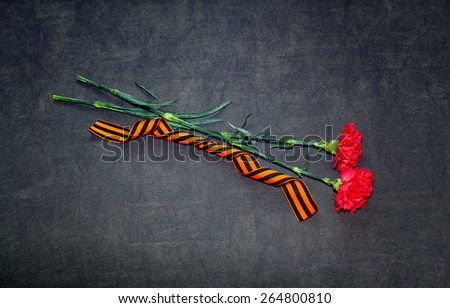 Carnation flowers and George Ribbon. 70 Years of Victory in the Great Patriotic War - stock photo