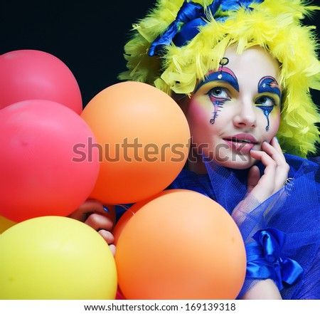 Carnaval woman with bright make up holding balloons - stock photo