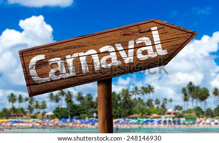 Carnaval wooden sign on the beach - stock photo