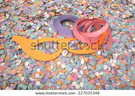 Carnival background with mask and confetti - stock photo