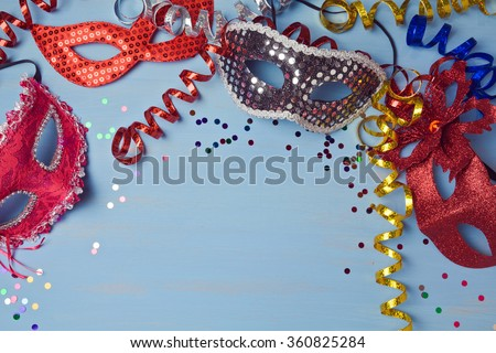 Carnival  background with mask, serpentine and confetti. View from above - stock photo