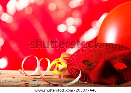 carnival background with ribbon and a mask - stock photo