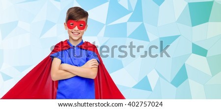 carnival, childhood, power, gesture and people concept - happy boy in red super hero cape and mask over blue low poly texture background - stock photo