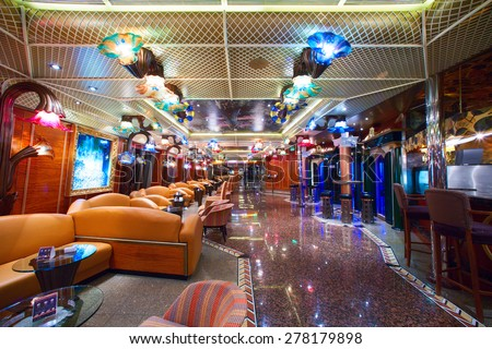 "CARNIVAL ""CONQUEST"" - 3:30 AM. JUNE 5, 2008: Cruise ship's main promenade deck. Different colorful lights making romantic ambiance. - stock photo"