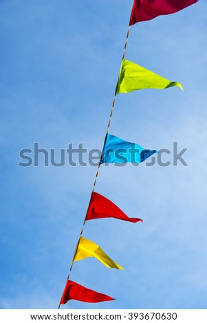 Carnival flags against a blue sky
