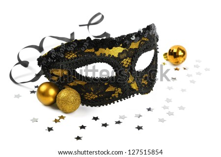 carnival golden mask with silver confetti on white background - stock photo