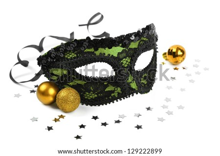 carnival green mask with silver confetti on white background