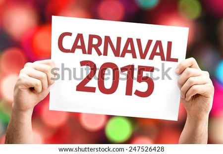 Carnival 2015 (in Portuguese) card with colorful background with defocused lights - stock photo