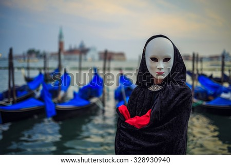 Carnival in Venice -  in background San Giorgio Maggiore church Venice, Italy (intentional motion blur). - stock photo