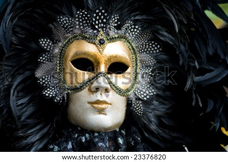 Carnival in venice with model dressed in various costumes and masks - black man