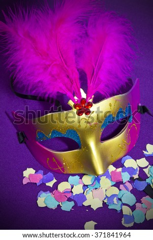 carnival mask and confetti - stock photo