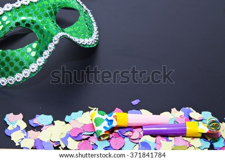 carnival mask and confetti and matasuegras - stock photo