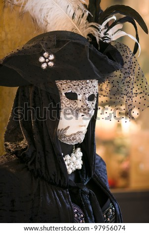 Carnival mask and costume in the streets of San Marco district - Venice, Venezia, Italy, Europe - stock photo