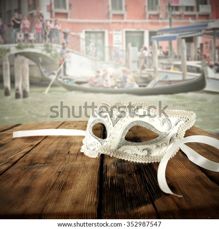 carnival mask and wooden desk and city landscape