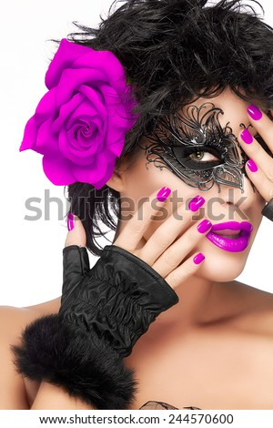 Carnival Mask. Glamorous beauty model wearing creative masquerade eye makeup and big purple rose flower on ear, closeup face portrait isolated on white. Fashion, beauty and makeup concept. - stock photo