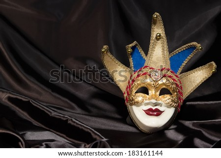 Carnival mask gold  against  background black theater