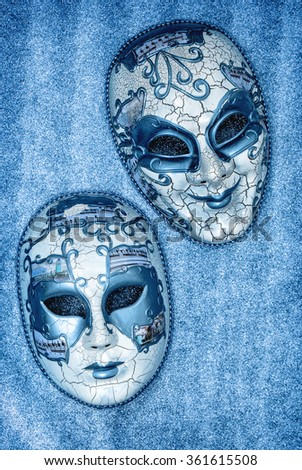 Carnival mask harlequin. Mardi gras. Holidays background. Blue toned. No name mass production goods - stock photo