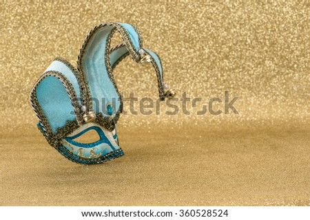 Carnival mask harlequin. Mardi gras. Holidays background. Symbol of venetian mask festival - stock photo