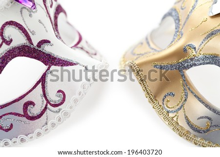 Carnival mask in spotlight on white background  - stock photo