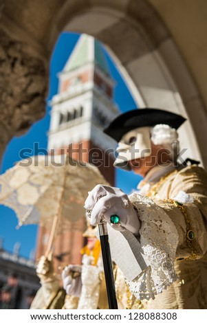 Carnival Mask in Venice Wonderful mask participant of the carnival celebrations in St. Mark's basin. Blurred background. - stock photo