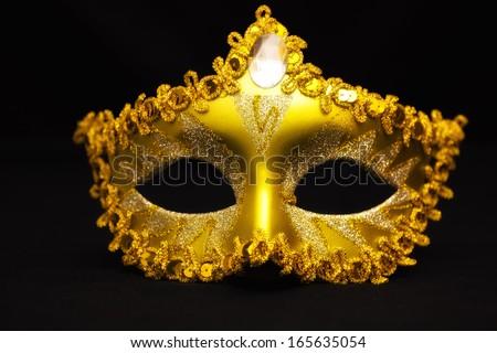 Carnival mask on a black background, Carnival mask, photography - stock photo