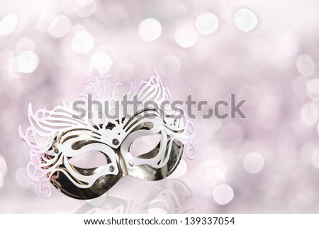 Carnival mask on a white background with pink glares - stock photo
