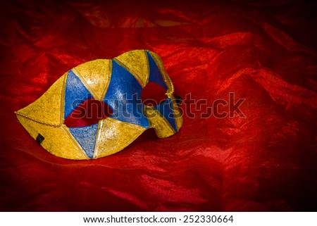 Carnival mask on red background - stock photo