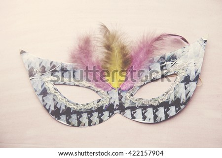 carnival mask on the pink table - stock photo