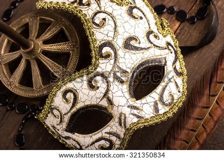 carnival mask over dark wooden background - stock photo