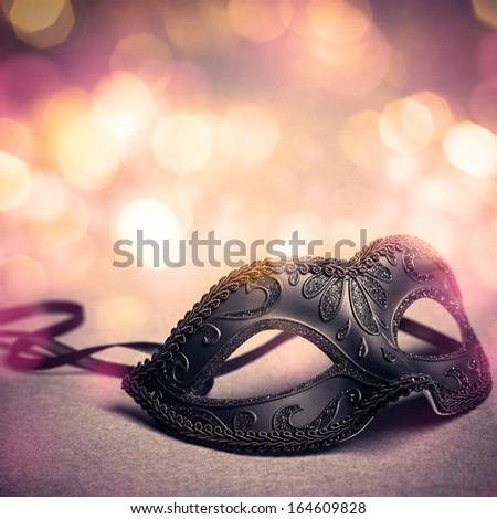 carnival mask over gold background - stock photo
