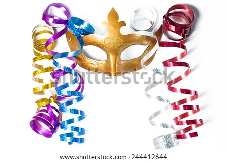 Carnival mask with colorful streamers on white background - stock photo